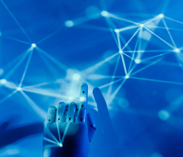 """The future of the digital world is still unknown, but what is essential is that we are productive today. (Credits: """"Robot's Hand on a Blue Background,"""" by Tara Winstead, licensed under Pexels.)"""