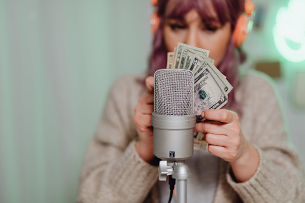 """Content creation is trendy nowadays as many platforms pay content creators for their content, such as Youtube. """"Woman in Gray Coat Holding Camera.,"""" by """"Karolina Grabowska,"""" licensed under """"Pexels."""
