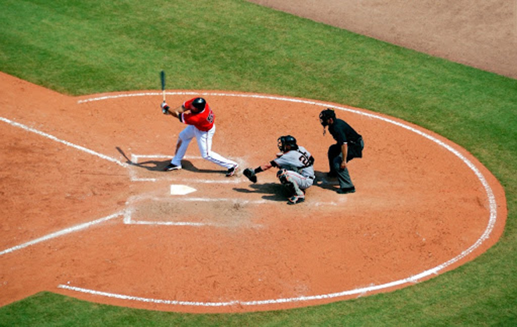 Google brings a three-strike policy with Google Ads accounts where you're going to know what the violations are. (Credits: Pixabay, Baseball Player Standing on Baseball Stadium With Two Men, Pexels License, Pexels)