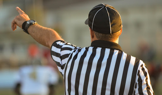 The strikes stay on your account for 90 days. After this time your warnings are deleted. (Credits: Nathan Shively, Macro View of a Referee, Unsplash License, Unsplash)